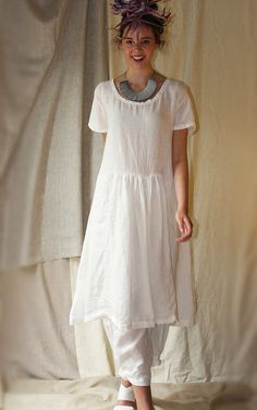Gorgeous Michell dress sewing pattern has short pop sleeve, inserted pleated ruffled panels front and back. Beautiful dress.