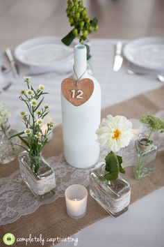 Burlap and lace: Rustic wedding centerpieces  Completely Captivating Photography {the blog}