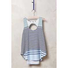 Anthropologie Striped Swing Tank This striped swing tank from the Anthropologie brand Deletta will keep you cool, no matter the weather. It's 100% cotton with a unique back cutout and a swingy shape. In excellent condition no holes, stains or tears. Worn once or twice. Please ask questions before purchase as all sales are final. Anthropologie Tops Tank Tops
