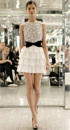 I love this outfit! Ruffled skirt, sequin flower top, black bow belt, and heels. So cute!