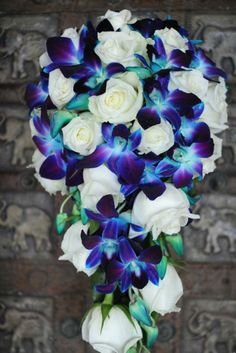 Galaxy-blue-dendrobium-orchids-white-roses