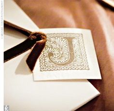The programs were exceptionally special: They were designed by a close friend of the bride and groom, and Lisa's mom painted a branch motif on the front of each program.