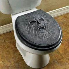 Vamp skull toilet seat .. this would be best on a black toilet