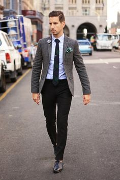 Opt for a grey wool blazer and black chinos if you're going for a neat, stylish look. Add black leather oxford shoes to your look for an instant style upgrade. Shop this look on Lookastic: https://lookastic.com/men/looks/blazer-dress-shirt-chinos-oxford-shoes-tie-pocket-square/628 — Green Polka Dot Pocket Square — Grey Wool Blazer — White Dress Shirt — Navy and Green Plaid Tie — Black Chinos — Black Leather Oxford Shoes