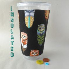 Owl faces adorn these feathers on this colorful and unique coffee cozy. Reusable, insulated, washable, durable and fun. No need to adjust this