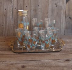 This is one of my favorite mid-century pattern. Bar ware Cocktail Mixer Highball Tumblers by SusieSoHoCollection, $75.00