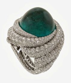Tropical Storm' Ring by James Currens of J.W. Currens. Platinum ring is centered with a 22.10-carat emerald surrounded by swirling patterns of diamonds (11.47 ctw.). This piece also took first place in the Classical category.