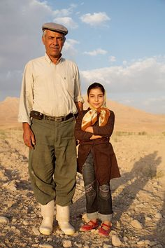 Iranian Man with his Daughter in Aghdash, Iran.