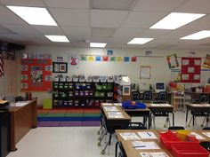 Great layout and creating subject specific areas! Plus, using the extra desks to place supplies! Very neat idea.