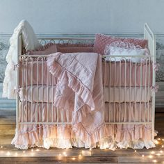 The Bella Notte cotton velvet and Whisper linen crib set offers irresistable texture and elegant style to a nursery. This eco-friendly bedding line features matching crib bumper, crib sheet, crib skirt, baby blanket, boudoir pillow, and decorative pillow options. Available in many colors .