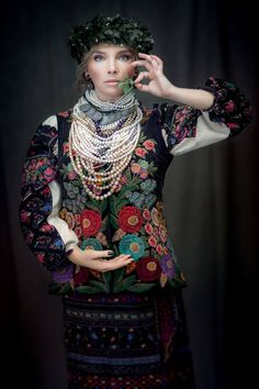 """""""Sincere"""" project. Costume from early XX century, sewing is typical for  Western skirts (Ternopil region). Headgear - wreath of myrtle and periwinkle. Jewelry - balamoots (petrified mother-of-pearl), pearls, beads of Venetian glass. Dressed: Olga Navrotska (fashion designer)"""