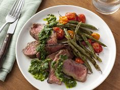 Healthy. inspired. lightly sear 5oz steak to a bake dish add 1/2 cup  spinach, 1/2 cup cherry tomatoes, and 1/2 cup green beans- bake at 375 degrees.