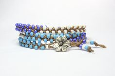 Wrap bracelet. ON SALE  Periwinkle blue, white and aqua turquoise seed beads.  Silver flower button.  Summer hippie.. $15.00, via Etsy.