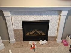 Let's just cut to chase and start with the before of my fireplace. The pros of this fireplace are the large size, lack of brass, a. fireplace makeover Fireplace Makeover with Tin Tile Cabin Fireplace, Fireplace Update, Backyard Fireplace, Farmhouse Fireplace, Marble Fireplaces, Fireplace Remodel, Fireplace Mantle, Fireplace Surrounds, Fireplace Design