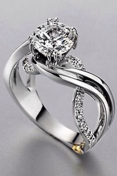 I would love something like this that's simple yet unique. Except maybe with a princess cut?