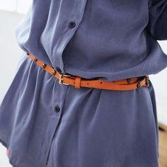 love the belt over dress shirt look