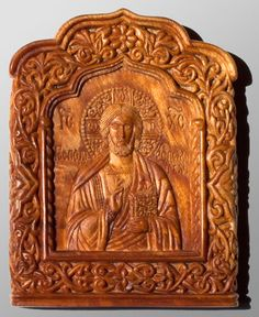 Carved icon miniature The Lord Almighty 5.1×6.6×0.7 cm; cypress wood (the root of cypress), natural linen oil varnish, 2004. Artists are Elena and Sergio Nikolenko.