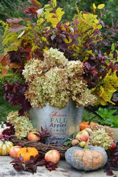 DIY Fall Harvest Arrangement Autumn Harvest Arrangement with flowers, foliage, pumpkins and apples