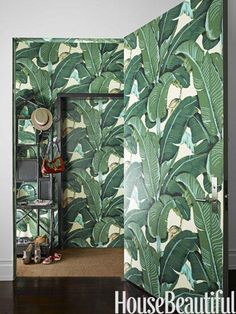 Designer Steven Sclaroff papers the walls and door of the tiny vestibule in Martinique, Hinson's iconic banana-leaf pattern that is practically synonymous with the Beverly Hills Hotel.