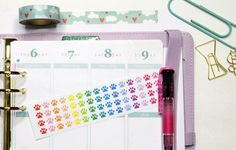 This set will include 60 small rainbow paw print stickers that look great in the weekly boxes of the erin condren life planner as you can see in