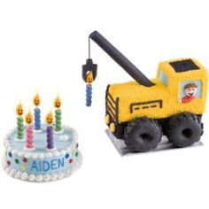 Construct a work site around a vibrantly decorated cake and an equally colorful crane created from a Choo Choo Train Pan cake. Beef up the birthday-boy connection with a piped-icing name and crane-operator face and Smiley Flames Chunky Candles.