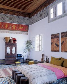 The original painted cedar ceiling in the bedroom of Stephen di Renza's home in Morocco was restored by hand.