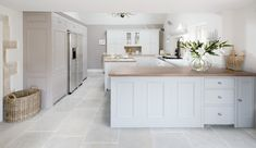 Classic Neptune Chichester cabinetry gives a nod to the building's heritage while the contemporary open-plan configuration is seamlessly integrated with a soft colour palette and natural stone flooring throughout.