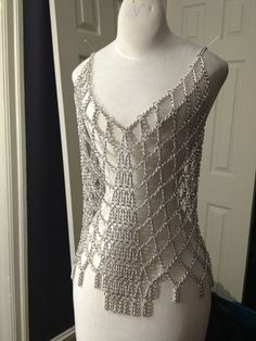 #chainmaille http://fc04.deviantart.net/fs71/i/2013/211/b/5/chain_dress_wip_by_utopia_armoury-d6fvkw3.jpg