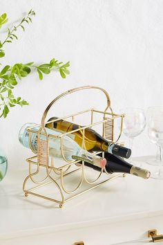 This handcrafted wine rack with rattan details not only showcases your favorite bottles, but serves as a beautiful piece of art perfect for an organic or eclectic interior. Anthropologie Christmas, Anthropologie Uk, Wine Rack Storage, Pantry Storage, Prego, Italian Wine, Kitchen Collection, Objet D'art, Wine Cellar