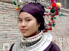 Flower-and-silver cladded Dong bride - China culture