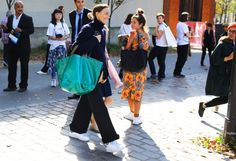 Phoebe Philo in Celine AND Stan Smiths. YES. Street Style: Paris Fashion Week Spring 2015, Part 2 — Vogue