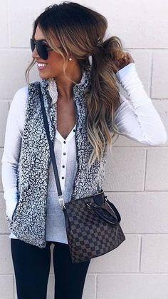 white top,leggings, grey vest, brown bag