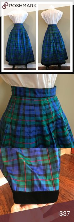 """Vintage Plaid Full Midi Maxi Skirt with Crinoline This vintage skirt is just stunning!  This is a blue, green, and red plaid midi/maxi skirt (depending on height) with a tulle lining and black velvet trim. Labeled as a size 6 but please note the measurements. It measures 13"""" across the waist and is 35.5"""" long. No material tag but feels like silk taffeta or a silk blend. Great to wear highwaisted! So classy! Vintage Skirts Midi"""