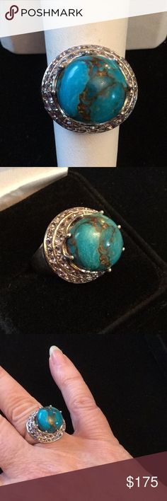 Elegant Genuine Turquoise & Tanzanite Ring ! This one is super Lux and artistic,  you have the stunning genuine turquoise round surrounded with genuine Tanzanite s.  This ring sits up high and regal and this turquoise is breathtaking,  set in a nice substantial .925.  Totally unique a real showpiece. Estate Sale Jewelry Rings