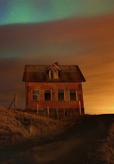 abandoned house looks to be out on the prairie, who lived here?