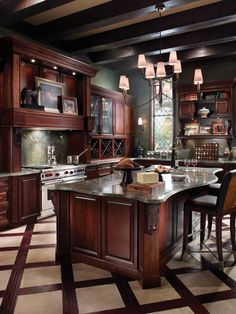(Kitchen, Classically Traditional, Photo 17 - KraftMaid) our wood floors will be mahogany. the dining room will be wood next to ceramic tile in kitchen area. look at the floor in this pic. LOVE IT!  now ? dark cabinets or white w glaze?
