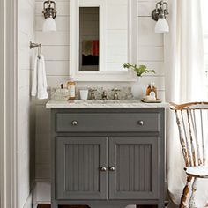 Pretty painted grey vanity, planked wall and a framed medicine cabinet. Use MirrorMate's Pacifica White Cap or any of the white frames in the line to get this look with a plain medicine cabinet! #mirrormate, #frameyourmirror Farmhouse Restoration | Master Bathroom | SouthernLiving.com