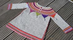 Lady Marion. Pattern here: http://www.ravelry.com/patterns/library/lady-marion-tunic. 2-8 years