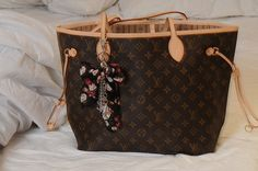 LV. Really want a purse by LV... One day!