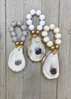 Cream, White, or Grey with brushed gold beads.Listing is for one napkin ring. Oyster Shell Crafts, Oyster Shells, Sea Shells, Seashell Art, Seashell Crafts, Seashell Projects, Diy Projects, Beaded Napkin Rings, White Beads