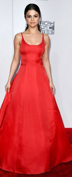 Who made Selena Gomez's red gown, jewelry, and silver platform sandals?