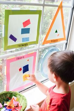 Shapes sun catcher. Sort shape cut outs into 4 basic shapes and stick them on the shape sun catchers (made with contact paper). Fun hands on way to learn shapes for toddlers.