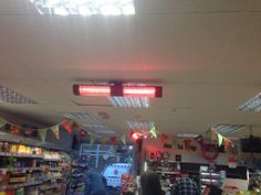 Here's an unusual picture. BN Thermic HWP patio heaters are being used to keep the checkout staff happy in a supermarket.