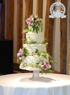 """""""Ivy and Roses"""" by the Little Cake Garden.  Rustic, buttercream wedding cake with fresh flowers for a barn wedding."""