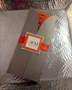Custom wedding invitation.  Metallic smoke grey and burnt orange gatefold invitation accented with a rhinestone seal.  www.theinviteonline.com @theinvite4u