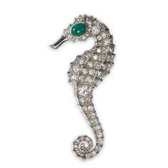 A diamond and emerald seahorse brooch