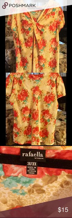 Beautiful flowered blouse Get ready for spring. Short sleeve blouse. Gathered together in the middle of the neckline for a flattering appeal Rafaella Tops Blouses