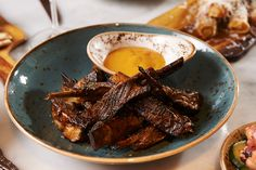 This is a recipe I created with my mother, Eleni and sweet hint - the thyme honey ouzo makes these ribs so moreish. Slow Roast Lamb, Lamb Ribs, Oven Roast, Lamb Recipes, Greek Recipes, Sbs Food, Finger Foods, Food Processor Recipes, Glaze
