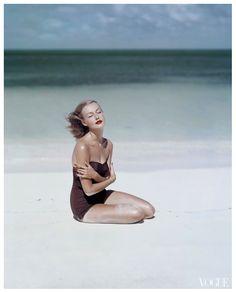 Liz Pringle as Liz Benn models a strapless swimsuit by Givenchy Vogue, 1953. Photo by John Rawlings