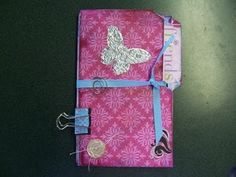 altered file folder with tags & binder clip